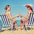 feliz · mulheres · garrafas · potável · praia · férias · de · verão - foto stock © dolgachov