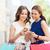 gülümseyen · kadın · alışveriş · çevrimiçi · insanlar · online · alışveriş - stok fotoğraf © dolgachov