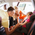 parents talking to little girl in baby car seat stock photo © dolgachov