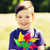 happy little boy with colorful pinwheel at summer stock photo © dolgachov