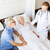 senior woman and doctor with clipboard at hospital stock photo © dolgachov
