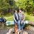 happy couple sitting on bench near camp fire stock photo © dolgachov