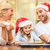 happy family in santa helper hats making cookies stock photo © dolgachov
