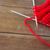 hand knitted item with knitting needles on wood stock photo © dolgachov