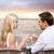 couple drinking wine in cafe on beach stock photo © dolgachov