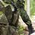 közelkép · fiatal · katona · katonai · egyenruha · háború · hadsereg - stock fotó © dolgachov