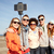 smiling friends taking selfie with smartphone stock photo © dolgachov