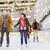 happy friends on skating rink stock photo © dolgachov