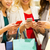 happy women with smartphones and shopping bags stock photo © dolgachov