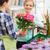 happy women choosing flowers in greenhouse stock photo © dolgachov