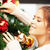 woman decorating christmas tree stock photo © dolgachov