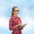 smiling girl in eyeglasses with tablet pc computer stock photo © dolgachov