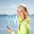woman listening to music outdoors stock photo © dolgachov