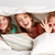 happy young women in bed at home pajama party stock photo © dolgachov