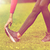close up of woman stretching leg outdoors stock photo © dolgachov