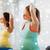 fitnessz · karácsony · nő · képzés · emel · kéz - stock fotó © dolgachov
