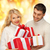 family couple in a sweaters with gift boxes stock photo © dolgachov