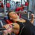 young man with earphones exercising on gym machine stock photo © dolgachov