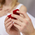 close up of hands holding little red gift box stock photo © dolgachov