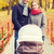 smiling couple with baby pram in autumn park stock photo © dolgachov