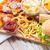 fast-food · lanches · mesa · de · madeira · insalubre · comer · hambúrguer - foto stock © dolgachov