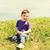 küçük · erkek · oturma · çim · çiçek · yüz - stok fotoğraf © dolgachov