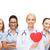 gülen · kadın · doktor · kalp · stetoskop · sağlık - stok fotoğraf © dolgachov