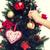 close up of woman with christmas tree decoration stock photo © dolgachov