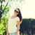 vrolijk · jonge · vrouw · zonnebril · lopen · buitenshuis - stockfoto © dolgachov