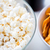 close up of popcorn and corn crisps or nachos stock photo © dolgachov