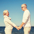happy senior couple holding hands summer beach stock photo © dolgachov