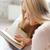 jonge · glimlachende · vrouw · sofa · lezing · boek · home - stockfoto © dolgachov