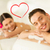 smiling couple lying on massage table in spa salon stock photo © dolgachov