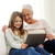 smiling family with tablet pc at home stock photo © dolgachov