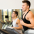 smiling men exercising on treadmill in gym stock photo © dolgachov