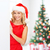 smiling young woman in santa hat with white board stock photo © dolgachov