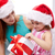 happy mother and child in santa hats with gift box stock photo © dolgachov