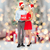 couple in santa hats with sale sign over lights stock photo © dolgachov