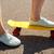 közelkép · női · láb · lovaglás · rövid · gördeszka - stock fotó © dolgachov
