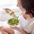 close up of pregnant woman eating salad at home stock photo © dolgachov