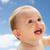 happy little baby boy or girl looking up stock photo © dolgachov