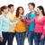 smiling teenagers making high five stock photo © dolgachov