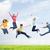 grupo · jovens · saltando · ao · ar · livre · grama · feliz - foto stock © dolgachov