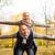 smiling couple having fun in autumn park stock photo © dolgachov