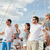 smiling friends sailing on yacht stock photo © dolgachov