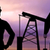 black silhouette of oil worker and pump jack stock photo © dolgachov