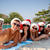 group of friends in santa hats with smartphone stock photo © dolgachov