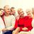 sonriendo · familia · cámara · casa · vacaciones · generación - foto stock © dolgachov