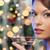 kadın · parti · üfleyici · noel · ağacı · ışıklar · tatil - stok fotoğraf © dolgachov