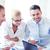 üzletasszony · csapat · megbeszélés · iroda · mosolyog · üzlet - stock fotó © dolgachov